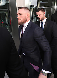 Conor McGregor (left) leaves Dublin District Court after appearing in relation to motoring offences.