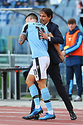 Joaquin Correa of Lazio celebrates with head coach Simone Inzaghi after scoring 2-0 goal during the Italian championship Serie A football match between SS Lazio and Bologna FC at Stadio Olimpico, Saturday, Feb. 29, 2020, in Rome, Italy.(Federico Proietti-ESPA-Images/Image of Sport)