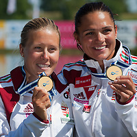 Danuta Kozák (L) and Katalin Kovács (R) from Hungary celebrate their victory in the K2 women Kayak 200m final of the 2011 ICF World Canoe Sprint Championships held in Szeged, Hungary on August 21, 2011. ATTILA VOLGYI