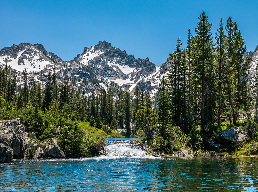Alice Lake with Snowyside Peak 10,650 ft 3246 meters in the Sawtooth National Recreation Area in Central Idaho on a beautiful summer day with emerald water and perfect clear skies. Licensing and Open Edition Prints.