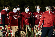 ORADELL, NJ - November 4: The President and coaches at Bergen Catholic have mandated all players to wear masks when they are not engaged in activity even if It is outside.<br /> <br /> We are in the midst of witnessing something this world has never experienced - a global pandemic. The coronavirus has swept away the world in March of 2020 - since then, the world we know It hasn't been the same. Jobs, businesses and futures have been put on hold and lost, yet, we have to power through to overcome one of the greatest obstacles this we have faced. The high school football season wasn't suppose to happen, but a glimmer of hope, intense safety measures & a little bit of luck has allowed for the season to start, now the question is ' Can It be completed?'<br /> <br /> Photo by Johnnie Izquierdo