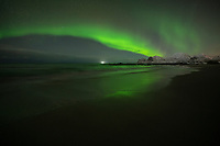 Small display of northern lights - aurora borealis over Storsandnes beach, Flakstadøy, Lofoten Islands, Norway