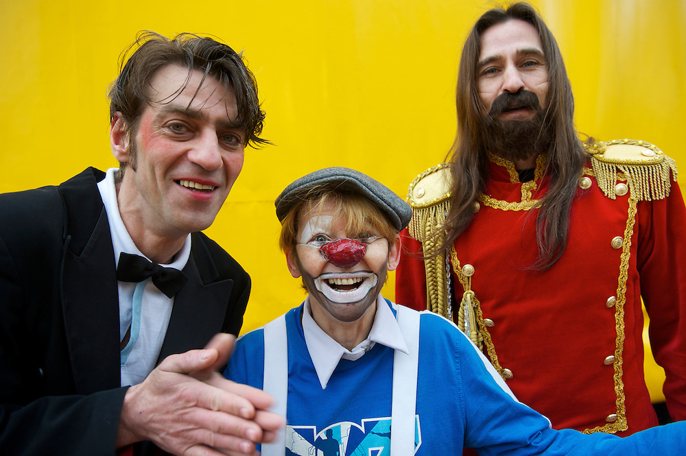 Ringmaster Andrey Voronin (R-L) and clowns Valentina Rumyantseva and Valery Kashkin, all performers from the Moscow State Circus, pose for a portrait the day before 10 days of consecutive performances in  Alexandara Palace, Muswell Hill, London.
