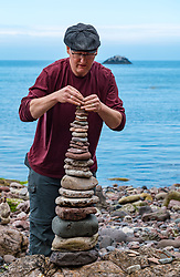 Dunbar, East Lothian, Scotland, United Kingdom 10 July 2021. European Stone Stacking Championship: The first day of the event, which is part of the Edinburgh Science Festival.  Pictured: Laurence Winram competes in the most stones stacked in half an hour competition. The record is 42.<br /> Sally Anderson | EdinburghElitemedia.co.uk