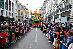 © Licensed to London News Pictures. 16/06/2019. London, UK. Hare Krishna pilgrims and devotees celebrate the 51st anniversary event of Rathayatra, and the annual Krishna Chariot festival is celebrated all over the world. Rathayatra - the wooden chariots carrying deities of Jagannatha, Balarama and Subhadra which are pulled by hand by pilgrims and devotees. Photo credit: Dinendra Haria/LNP