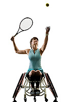 one caucasian young handicapped tennis player woman in wheelchair sport  tudio in silhouette isolated on white background