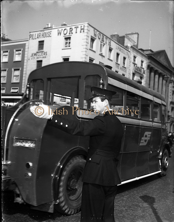 01/05/1958<br /> 05/01/1958<br /> 01 May 1958 <br /> Garda on Duty in Dublin City Centre.  Garda directing traffic on O'Connell Street, Dublin. Note the CIE bus.