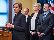 """10 MARCH 2020 - DES MOINES, IOWA:  KIM REYNOLDS, the Governor of Iowa, talks to reporters about the coronavirus and COVID-19 illness during a press conference in her office Tuesday. The Governor said there are 8 possible coronavirus cases in Iowa as of Tuesday morning and that 7 of those cases had been passengers on the same cruise. She also said 22 Iowans had been on other cruises and that 14 of those people were self quarantined in their homes. She said """"COVID-19 is now here (in Iowa). This is not cause for alarm."""" COVID-19 has been reported in all of the states around Iowa, except South Dakota, and Iowa officials are working with public health officials in neighboring states. The coronavirus outbreak is expected to cost Iowa more than $200 million.   PHOTO BY JACK KURTZ"""