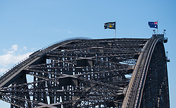 General view of the Invictus Games flag flying alongside the Australian flag on Sydney Harbour Bridge on the fourth day of the Duke and Duchess of Sussex's visit to Australia.