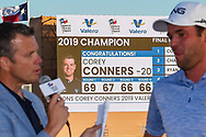 Corey Conners (CAN) is interviewed on the green on 18 with a congratulations sign in near the bunkers after winning the Valero Texas Open, at the TPC San Antonio Oaks Course, San Antonio, Texas, USA. 4/7/2019.<br /> Picture: Golffile | Ken Murray<br /> <br /> <br /> All photo usage must carry mandatory copyright credit (© Golffile | Ken Murray)