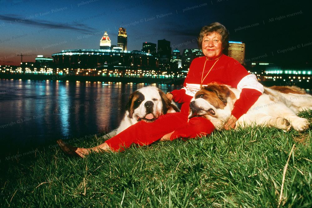 Marge Schott, owner of the Cincinatti Reds with her St. Bernards, mascots of the team.