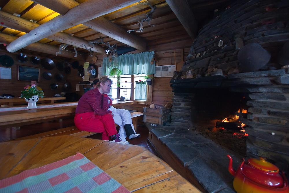 Skiers rest in a Savotta lodge in Lapland, Finland.