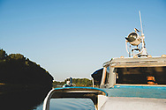 The captain of a Dniester River cruise boat drives his vessel and passengers on a one-hour cruise in Tiraspol, Transnistria.<br /> <br /> (September 10, 2016)