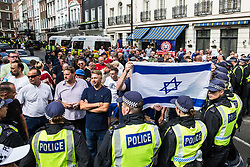 London, UK. 10th June, 2018. Members of far-right groups hold an Israeli flag as they protest against the pro-Palestinian Al Quds Day march through central London organised by the Islamic Human Rights Commission. An international event, it began in Iran in 1979. Quds is the Arabic name for Jerusalem.