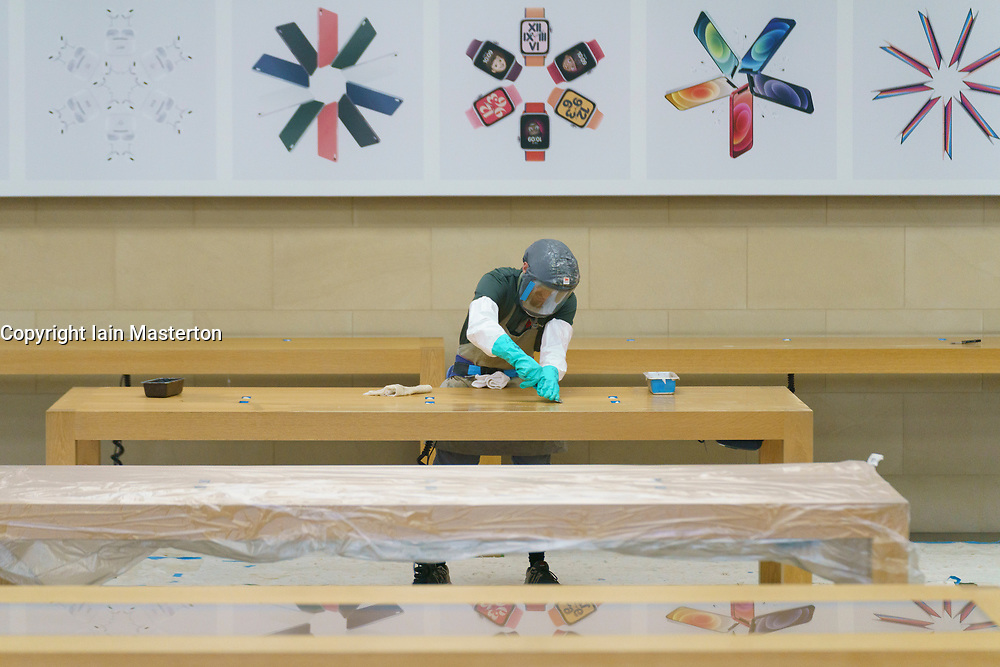 Edinburgh, Scotland, UK. 13 January 2020. Shops in Scotland now generally prohibited from offering Click and Collect service from front doors with some exceptions depending on type of goods on sale. Pic : Apple store is closed and empty of stock and opportunity is taken to give interior a deep clean by workers in full PPE. Iain Masterton/Alamy Live News