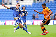 Cardiff City's Joe Ralls (l) challenges Wolves' Rajiv Van La Parra. Skybet football league championship match, Cardiff city v Wolverhampton Wanderers at the Cardiff city stadium in Cardiff, South Wales on Saturday 22nd August 2015.<br /> pic by Carl Robertson, Andrew Orchard sports photography.