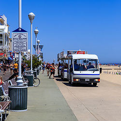 Ocean City, MD / USA - May 26, 2018: A tram transports visitors on the Ocean City boardwalk.