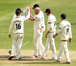 Durham's Chris Rushworth celebrates the wicket of Middlesex's Ollie Rayner with his teammates - Photo mandatory by-line: Robbie Stephenson/JMP - Mobile: 07966 386802 - 03/05/2015 - SPORT - Football - London - Lords  - Middlesex CCC v Durham CCC - County Championship Division One
