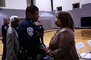 SFPD Police Chief William Scott is greeted by Gwendolyn Woods, mother of Mario Woods, during Scott's first town hall meeting as the city's newly-sworn police chief in San Francisco, Calif., Thursday, May 9, 2017.<br /> <br /> Woods' death by SFPD in December 2015 sparked a series of protests in the Bay Area that ultimately led to the resignation of former Police Chief Greg Suhr.<br /> <br /> Chief Scott, a 27-year veteran of the Los Angeles Police Department, was sworn in by the late Mayor Edwin M. Lee replacing acting Chief Toney Chaplin on January 23, 2017.