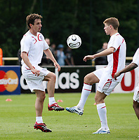 Photo: Chris Ratcliffe.<br />England training session. 06/06/2006.<br />Gary Neville and Steven Gerrard go toe to toe.