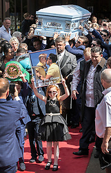© Licensed to London News Pictures. 21/08/2018. Ashtead, UK. Family members mourn as the coffin of traveller Mikey Connors is carried from St Michaels Church in Ashtead. 32 year-old Mikey Connors, the nephew of My Big Fat Gypsy Wedding star Paddy Doherty, was killed when his horse-and-cart was hit by a car in Thamesmead on July 28. Photo credit: Peter Macdiarmid/LNP