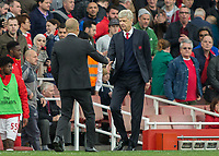 Football - 2016 / 2017 Premier League - Arsenal vs. Manchester City.<br /> <br /> Pep Guardiola Manager of Manchester City and Arsenal Manager Arsene Wenger  shake hands at the end of the game at The Emirates.<br /> <br /> COLORSPORT/DANIEL BEARHAM