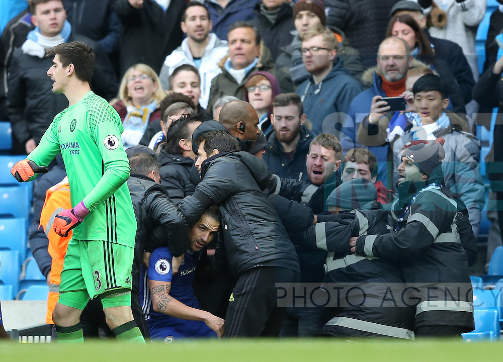 Cesc Fabregas of Chelsea is protected after he was pushed into the crowd during the Premier League match at the Etihad Stadium, Manchester. Picture date: December 3rd, 2016. Pic Simon Bellis/Sportimage