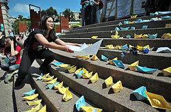 May 25, 2019 - Kyiv, Ukraine - A woman puts a paper boat onto the steps during the meeting in support of Ukrainian sailors detained by the Russian Federation holds a paper boat, Kyiv, capital of Ukraine, May 25, 2019. Ukrinform. /VVB/ (Credit Image: © Olena Khudiakova/Ukrinform via ZUMA Wire)