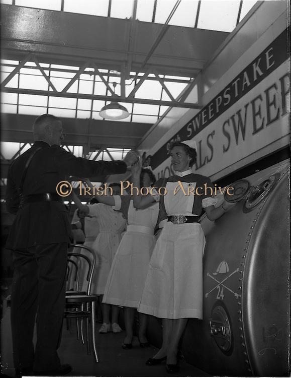 22/10/1959<br /> 10/22/1959<br /> 22 October 1959<br /> Irish Hospitals Trust 97th Sweepstake Draw on Cambridgeshire 1959 at Irish Hospital Sweepstakes office, Ballsbridge, Dublin. Garda Superintendent collecting tickets from the nurses.