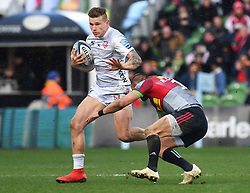 Gloucester's Jason Woodward (left) is tackled by Harlequins Ross Chisholm during the Gallagher Premiership match at Twickenham Stoop, London.