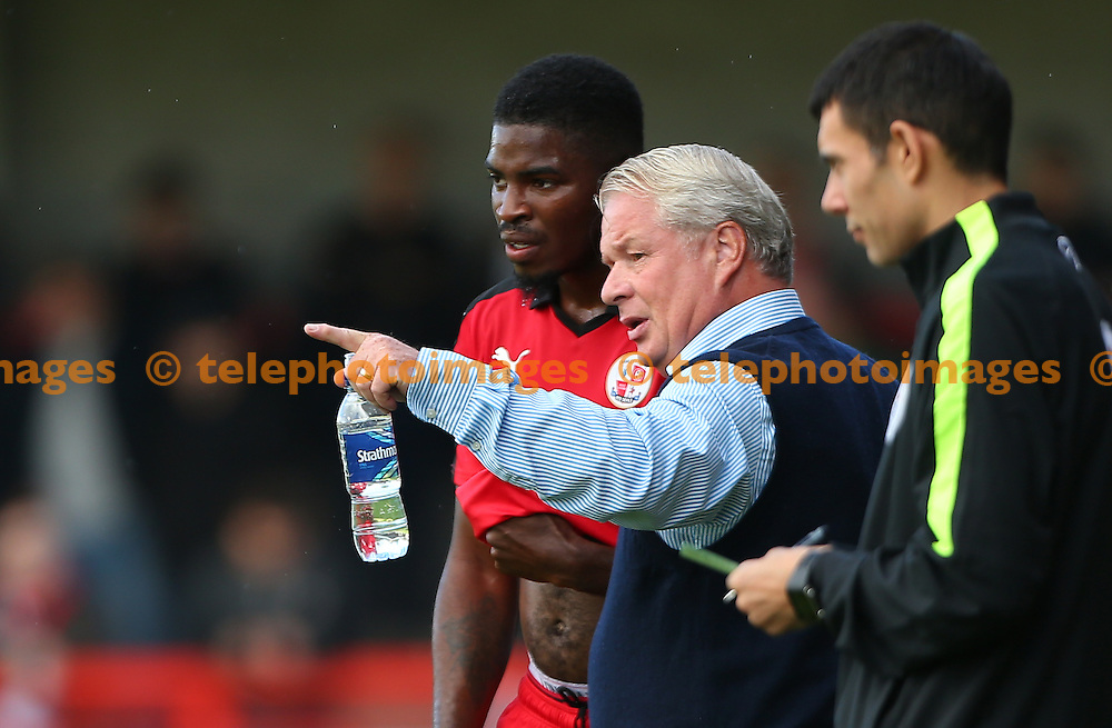 -cma- gives instructions to  Andre Blackman during the Sky Bet League 2 match between Crawley Town and Blackpool at the Checkatrade Stadium in Crawley. October 1, 2016.<br /> James Boardman / Telephoto Images<br /> +44 7967 642437