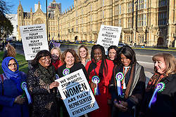 © Licensed to London News Pictures. 06/02/2018. LONDON, UK.  (2nd left) Diane Abbott joins female members of the Shadow Cabinet and Labour politicians outside the Houses of Parliament, wearing Labour styled suffragette rosettes, holding placards next to a '100 Years of Women Voting' banner to help launch Labour's campaign to celebrate 100 years of women's suffrage.    Photo credit: Stephen Chung/LNP