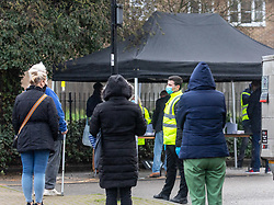 © Licensed to London News Pictures. 02/02/2021. London, UK. Members of the public queue up to get tested in West London this morning. Staff prepare a Covid testing centre in a high risk area of Hanwell as the Covid-19 South African variant spreads across London. Yesterday, two people tested positive in Woking, Surrey for the South African variant by community transmission with no links to South Africa as 80,000 people in the South East will be offered urgent Covid-19 tests as Health Minister Matt Hancock urged residents in high risk areas to take extra special precautions . Photo credit: Alex Lentati/LNP