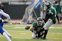 15 November 2014:  Michael Kelley kicks an extra point held by Jack Warner during an NCAA division 3 football game between the North Park Vikingsand the Illinois Wesleyan Titans in Tucci Stadium on Wilder Field, Bloomington IL