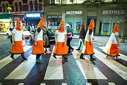 © Licensed to London News Pictures . 26/12/2017. Wigan, UK. Traffic cones. Revellers in Wigan enjoy Boxing Day drinks and clubbing in Wigan Wallgate . In recent years a tradition has been established in which people go out wearing fancy-dress costumes on Boxing Day night . Photo credit: Joel Goodman/LNP