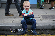 a Young West Ham United boy posing with the Iron Cross sits on the pavement outside Boleyn Ground before k/o. scenes around the Boleyn Ground, Upton Park in East London as West Ham United play their last ever game at the famous ground before their move to the Olympic Stadium next season. Barclays Premier league match, West Ham Utd v Man Utd at the Boleyn Ground in London on Tuesday 10th May 2016.<br /> pic by John Patrick Fletcher, Andrew Orchard sports photography.
