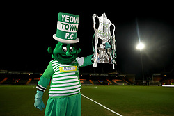 Yeovil Town mascot the Jolly Green Giant on the pitch before the Emirates FA Cup, fourth round match at Huish Park, Yeovil.