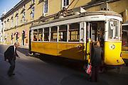 Typical Lisbon trams passing near Terreiro do Paço square.
