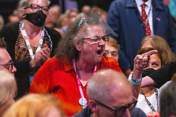 © Licensed to London News Pictures. 29/09/2021. Brighton, UK. A woman in the audience heckles during the speech . Sir Keir Starmer delivers the leader's speech at the close of the conference . The final day of the 2021 Labour Party Conference , which is taking place at the Brighton Centre . Photo credit: Joel Goodman/LNP