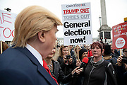 Donald Trump lookalike listens to a vocal protester in Trafalgar Square during protests against the state visit of US President Donald Trump on 4th June 2019 in London, United Kingdom. Organisers Together Against Trump which is a collaboration between the Stop Trump Coalition and Stand Up To Trump, have organised a carnival of resistance, a national demonstration to protest against President Trump's policies and politics during his official UK visit.