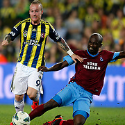 Fenerbahce's Miroslav Stoch (L) and Trabzonspor's Deguy Alain Didier Zokora (R) during their Turkish Superleague soccer derby match Fenerbahce between Trabzonspor at the Sukru Saracaoglu stadium in Istanbul Turkey on Monday 24 September 2012. Photo by TURKPIX