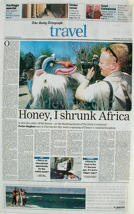 25 April 1998. Orlando, Florida.<br /> Front page, Daily Telegraph, London. Travel section.<br /> Having my images published on the front pages is nothing new to me, however, having an image of me appear on the front of the Daily Telegraph's travel section was a bit of a surprise. In April 1998 I was dispatched to Orlando to cover the opening of Disney World's latest attraction, the new 'Animal Kingdom.' Seems Steve Benbow's image of me up close and personal with one of the characters was too good to pass up.<br /> Photo; Steve J Benbow.