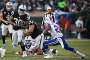 Oakland Raiders defensive back SaQwan Edwards (30) carries the ball through the Buffalo Bills defense at Oakland Coliseum in Oakland, Calif., on December 4, 2016. (Stan Olszewski/Special to S.F. Examiner)
