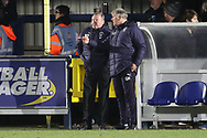 AFC Wimbledon manager Wally Downes and AFC Wimbledon first team coach Glyn Hodges talking on touchloine during the EFL Sky Bet League 1 match between AFC Wimbledon and Barnsley at the Cherry Red Records Stadium, Kingston, England on 19 January 2019.