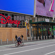 The Disney Store in Times Square is boarded up as streets remain sparse to both visitors and traffic during the Coronavirus (Covid-19) pandemic on Tuesday, January 19, 2021 in Manhattan, New York. (Alex Menendez via AP)