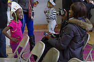 """Middletown, New York - A young girl smiles for the camera after performing in the """"YMCA Thanksgiving Day Spectacular"""" at the Center for Youth Programs on Nov. 27, 2013."""