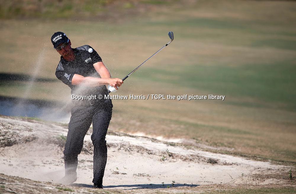 Henrik STENSON (SWE) plays bunker shot at 5th during fourth round US Open Championship 2014,Pinehurst No 2,Pinehurst,North Carolina,USA.
