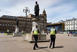 Glasgow, Scotland, UK. 12 June 2020. Police patrol George Square in the city centre to prevent vandalism to the many historic statues located here. Following the recent Black Lives Matter demonstrations in the UK,  many colonial era statues have been targeted by protestors.  Iain Masterton/Alamy Live News