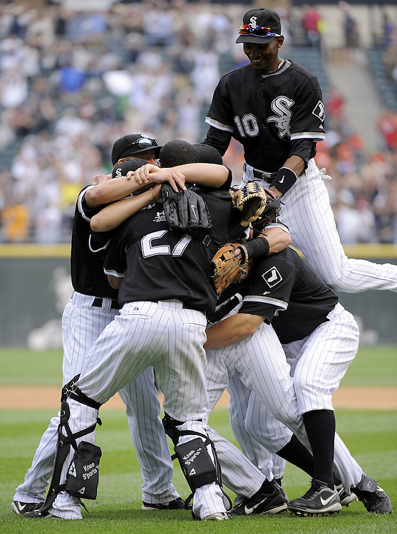 CHICAGO - JULY 23:  Mark Buehrle #56 of the Chicago White Sox is mobbed by teammates after Buehrle recorded the 18th perfect game in major league history against the Tampa Bay Rays on June 23, 2009 at U.S. Cellular Field in Chicago, Illinois.  The White Sox defeated the Rays 5-0.  (Photo by Ron Vesely)