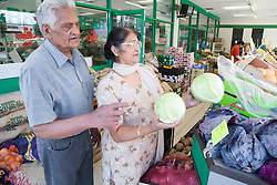 Older couple out shopping for vegetables,
